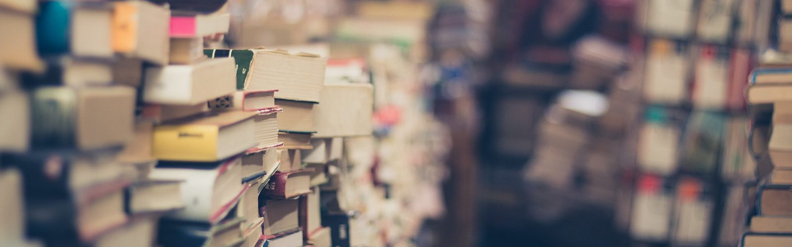 Books stacked in a bookshop